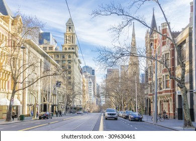 Melbourne, Australia - August 16, 2015: Victorian era buildings in Collins Street in Melbourne's CBD with modern buildings in the distance near sunset.