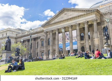 Melbourne, Australia - August 16, 2015: View of the facade, forecourt and lawn of the State Library of Victoria in Melbourne during daytime.