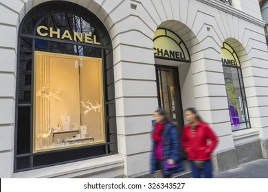 Melbourne, Australia - August 16, 2015: Shoppers walking pass Chanel store in Melbourne. Chanel is a high fashion house specialising in haute couture, luxury goods and fashion accessories.