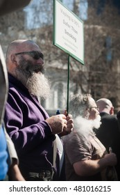 Melbourne, Australia - August 16, 2016: Vapers gathered at Parliament House in Melbourne, Victoria, to protest the introduction of new laws that would treat vaping like smoking.