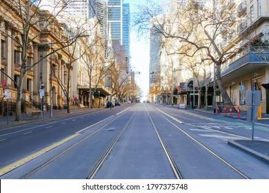 Melbourne, Australia - August 17, 2020: Collins St within Melbourne CBD is quiet and deserted during the Coronavirus pandemic.