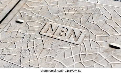 Melbourne, Australia - August 2, 2018: A Concrete man hole cover with the NBN label and pattern in the concrete