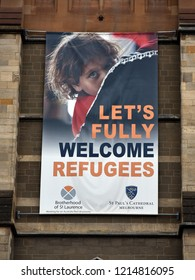 Melbourne, Australia - August 23, 2018: A poster welcoming refugees is seen hanging from outside St Paul's Cathedral.