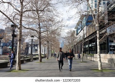 Melbourne, Australia - August 23, 2018: People pass through the waterfront of Melbourne's central business district.