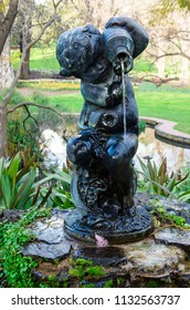 Melbourne, Australia - August 30, 2015: The Boy and Urn fountain from circa 1900 in Fitzroy Gardens was stolen on 18 March 2016 and remains missing.