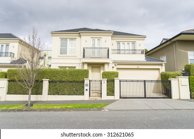 Melbourne, Australia - August 30, 2015: Contemporary two storey Australian house in Melbourne during daytime.