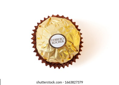 Melbourne, Australia circa February 2020: Top view of Ferrero Rocher chocolate isolated on white background with shallow focus.