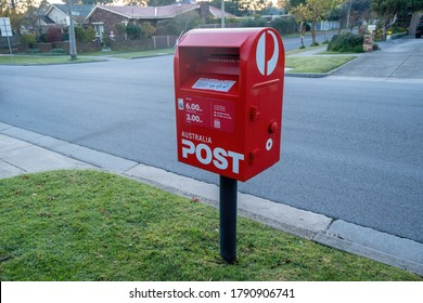Melbourne, Australia - circa May, 2020: Red post box on suburban street