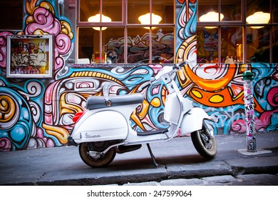 Melbourne, Australia - December 20 - Melbourne's famous Hosier Lane with motorcycle and graffiti on December 20th 2013.