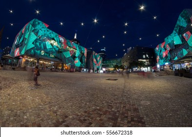 Melbourne, Australia - December 23, 2015: Festive Christmas light projections on the building facades of Federation Square, a popular public open space in central Melbourne.