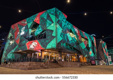 Melbourne, Australia - December 23, 2015: Festive Christmas light projections on the SBS Television building facade at Federation Square, a popular public open space in central Melbourne.