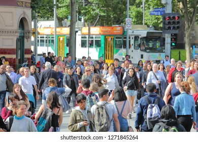 MELBOURNE AUSTRALIA - DECEMBER 3, 2018: Unidentified people cross street in downtown Melbourne Australia