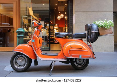MELBOURNE AUSTRALIA - DECEMBER 3, 2018: Orange Vespa scooter motorbike flower basket