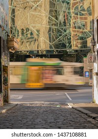 Melbourne, Australia - December 30, 2017: Looking at Federation Square from Hosier Lane, with a tram passing by.