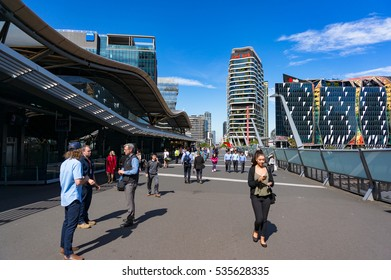 Melbourne, Australia - December 7, 2016: Southern Cross railway station bridge with people and skyline on the background