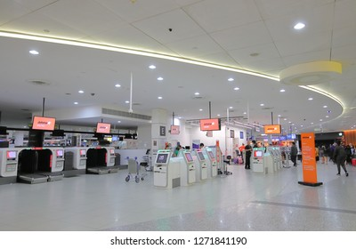 MELBOURNE AUSTRALIA - DECEMBER 9, 2018: Unidentified people check in at Jetstar check in counter Melbourne International airport in Melbourne Australia.