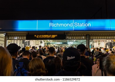 Melbourne, Australia - February 10, 2018: crowd of people queuing outside Richmond Railway Station after an evening cricket match. Richmond Station provides access to the MCG.