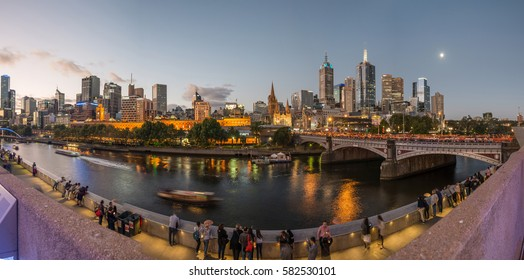 MELBOURNE, AUSTRALIA - FEBRUARY 20 2016: Panoramic view of Melbourne cityscape during the White Night festival in the evening. Victoria state of Australia.