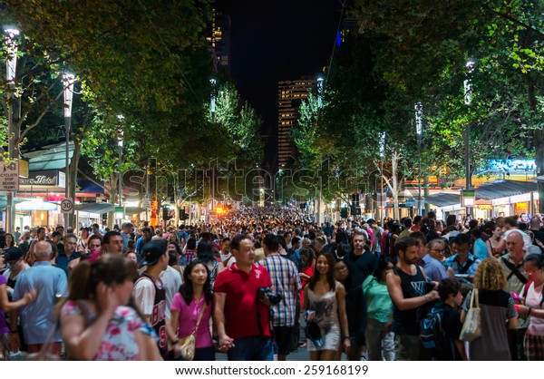 MELBOURNE, AUSTRALIA - February 22, 2015: people crowding Swanston Street in central Melbourne during the White Night overnight arts festival, which an estimated 500,000 people attended.
