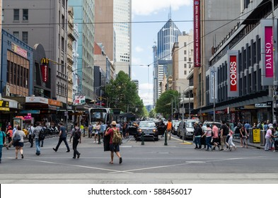 Melbourne, Australia - February 23, 2017: the intersection of Flinders Street and Elizabeth Street in Mebourne is one of the busiest for pedestrian traffic. This is the view west along Elizabeth Str.