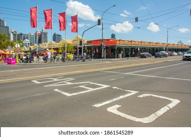 """Melbourne, Australia – February 23, 2020 - View of the Queen Victoria Market (aka Vic Market or Queen Vic) across the street with the """"clear"""" sign on the floor, Melbourne, Victoria"""