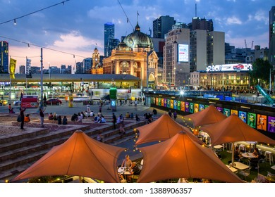 Melbourne, Australia - February 7, 2019 : Looking down on the Time Out Cafe at Federation Square with the historically significant Flinders Street Station in the background.