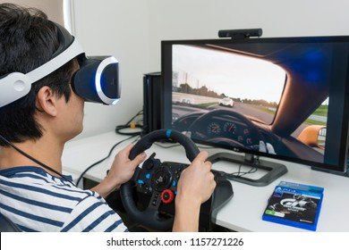 Melbourne, Australia - Jan 30, 2018: Man playing Gran Turismo Sport on PlayStation 4 Pro with Playstation VR and steering wheel at home. GT Sport is a very popular racing game.