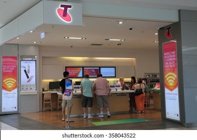 MELBOURNE AUSTRALIA - JANUARY 1, 2016: Unidentified people shop at Telstra store. Telstra is the largest telecommunications and media company in Australia.