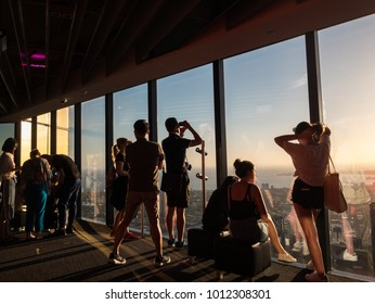 Melbourne, Australia - January 16, 2018: tourists looking out the windows of Eureka Skydeck, a popular tourist attraction in Melbourne.