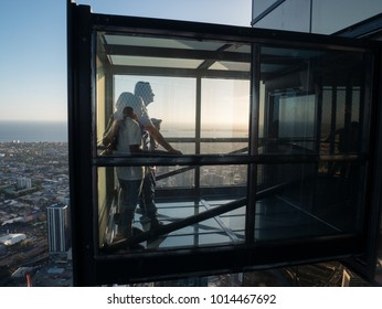 Melbourne, Australia - January 16, 2018: The Edge extends from the 88th floor of Eureka Tower, the highest building in Melbourne and a popular tourist attraction.