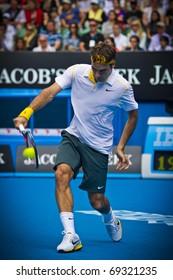 MELBOURNE, AUSTRALIA - JANUARY 17:  Roger Federer(SUI)[2] defeats Lukas Lacko(SVK) at the 2011 Australian Open on January 17, 2011 in Melbourne, Australia