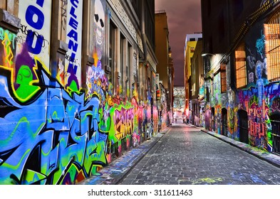 Melbourne, Australia - January 18, 2015: Night view of colorful graffiti artwork at Hosier Lane in Melbourne on January 18, 2015.