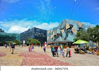 Melbourne, Australia - January 18 : People visit Federation Square in Melbourne city cetre on January 18, 2015. The square is a public space created in 2002 in the heart of Melbourne.