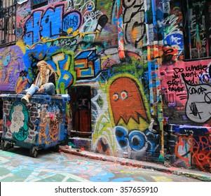 MELBOURNE AUSTRALIA - JANUARY 2, 2016: Unidentified people visit Hosier lane. Melbourne's graffiti management plan recognises the importance of street art.
