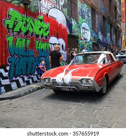 MELBOURNE AUSTRALIA - JANUARY 2, 2016: Classic car parks in Hosier lane. Melbourne's graffiti management plan recognises the importance of street art.