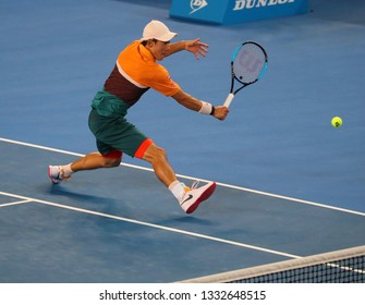 MELBOURNE, AUSTRALIA - JANUARY 21, 2019: Professional tennis player Kei Nishikori of Japan in action during his round of 16 match at 2019 Australian Open in Melbourne Park