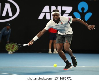 MELBOURNE, AUSTRALIA - JANUARY 22, 2019: Professional tennis player Frances Tiafoe of United States in action during his quarter-final match against Rafael Nadal at 2019 Australian Open in Melbourne