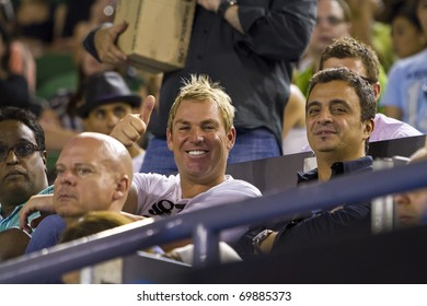 MELBOURNE, AUSTRALIA - JANUARY 22: Cricket Legend Shane Warne & Friend Joe Hachem at the Rod Laver Arena which holds the center court at the Australian Open, January 22, 2011 in Melbourne, Australia
