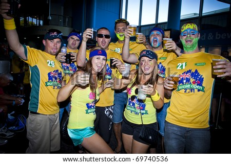 MELBOURNE, AUSTRALIA - JANUARY 22: A group of Australian supporters with beers inside the Rod Laver Arena which holds the center court at the Australian Open, January 22, 2011 in Melbourne, Australia