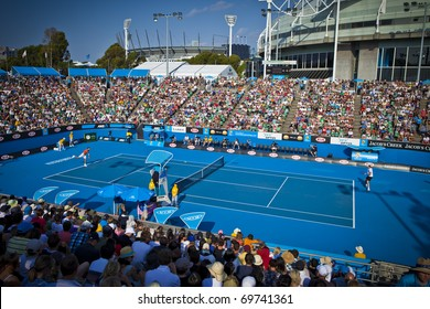 MELBOURNE, AUSTRALIA - JANUARY 22: Margaret Court Arena, Melbourne Cricket Ground Stadium in background & Rod Laver Arena with center court at Australian Open, January 22, 2011 in Melbourne, Australia