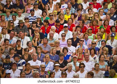 MELBOURNE, AUSTRALIA - JANUARY 22: Some of the sell out crowd inside the Rod Laver Arena, center court at the Australian Open, January 22, 2011 in Melbourne, Australia