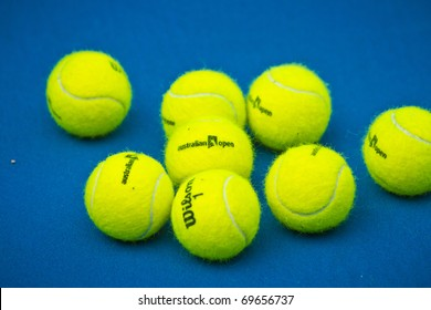 MELBOURNE, AUSTRALIA - JANUARY 22:  Used game balls on the center court at the Rod Laver Arena at the Australian Open, January 22, 2011 in Melbourne, Australia