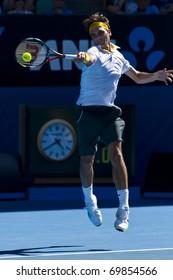 MELBOURNE, AUSTRALIA - JANUARY 23: Roger Federer(SUI)[2] defeats Tommy Robredo(ESP) at the Australian Open on January 23, 2011 in Melbourne, Australia