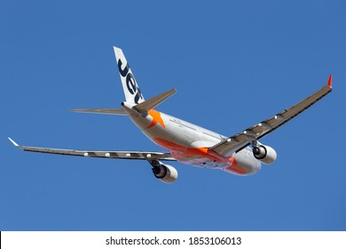 Melbourne, Australia - January 25, 2014: Jetstar Airways Airbus A330-202 VH-EBJ climbing on departure from Melbourne International Airport.