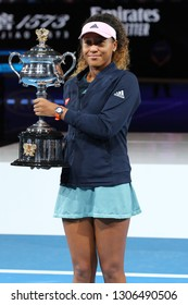 MELBOURNE, AUSTRALIA - JANUARY 26, 2019: 2 times Grand Slam Champion Naomi Osaka of Japan posing with Australian Open trophy after her victory in final match at 2019 Australian Open in Melbourne Park