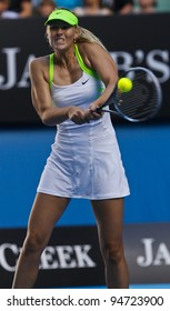MELBOURNE, AUSTRALIA - JANUARY 26: Maria Sharapova of Russia hits a return to Petra Kvitova of Russia during Australian Open tennis tournament, January 26, 2012 in Melbourne, Australia.