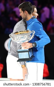 MELBOURNE, AUSTRALIA - JANUARY 27, 2019: Rafael Nadal of Spain (L) congratulates 2019 Australian Open champion Novak Djokovic with victory during trophy presentation after men's final match
