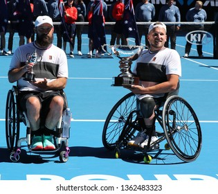 MELBOURNE, AUSTRALIA - JANUARY 27, 2019: David Wagner of USA (L) and  Grand Slam champion Dylan Alcott of Australia pose with trophy after 2019 Australian Open quad wheelchair singles final match