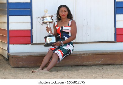 MELBOURNE, AUSTRALIA - JANUARY 27, 2019: 2 times Grand Slam Champion Naomi Osaka of Japan posing with Australian Open trophy at Brighton Beach in Melbourne after her victory at 2019 Australian Open