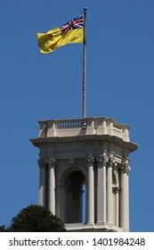 MELBOURNE, AUSTRALIA - JANUARY 28, 2019: The flag of the Governor of Victoria raised over the belvedere tower of Government House, Melbourne.